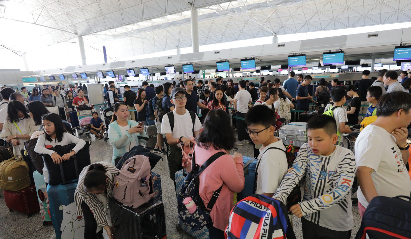 Hundreds of flights cancelled leaving travellers facing chaos as citywide strike action hits Hong Kong International Airport.
